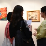 The artist, Romero (on right), discussed with visitors about the artwork.
