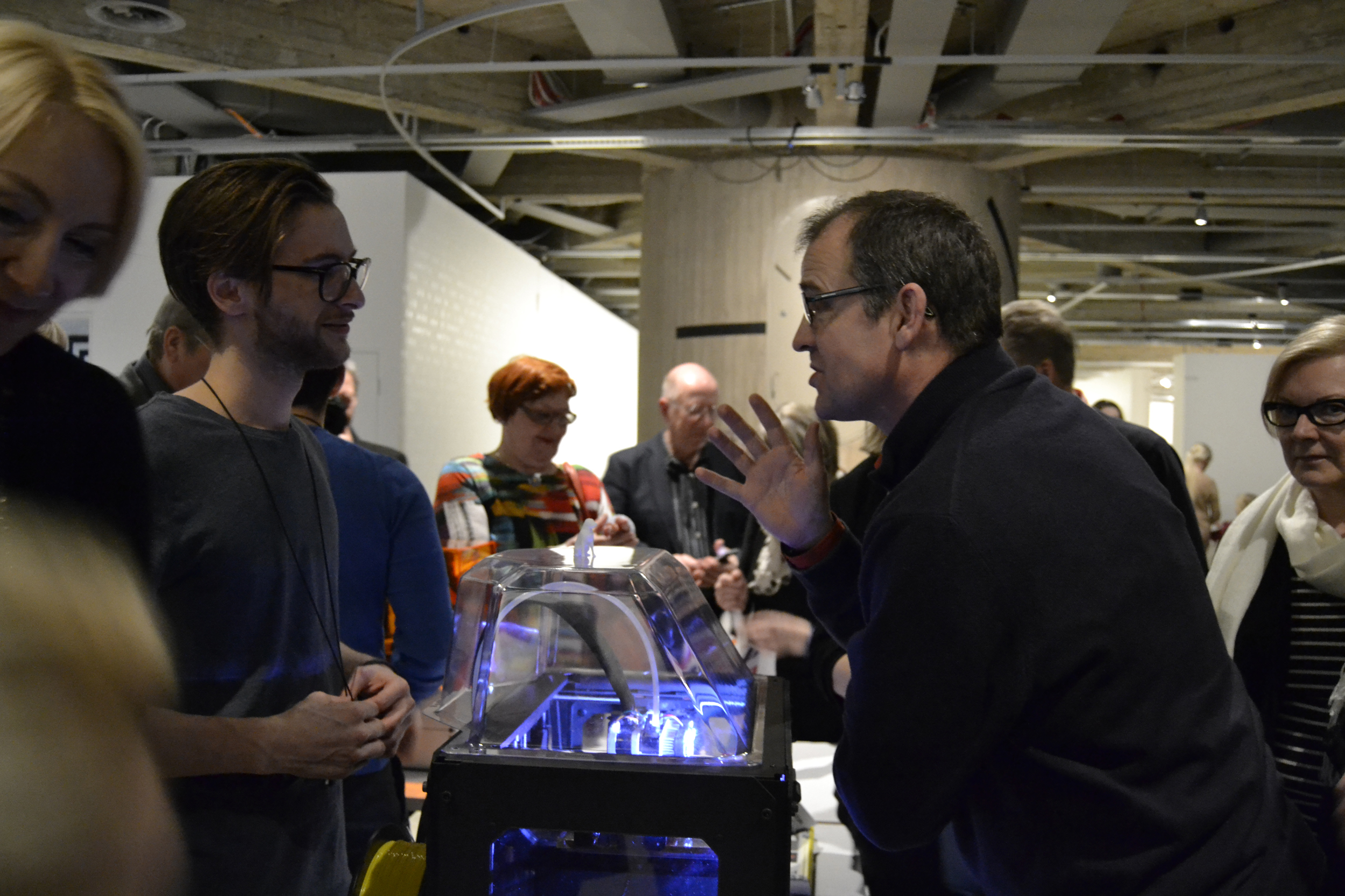 """""""This is the first time I'm seeing the process of the printing, although I've seen 3D printed items before,"""" said John Calton (on right), who discussed about the commercial possibilities of 3D printing technology with FabLab's Charlie Banthorpe (on left)."""